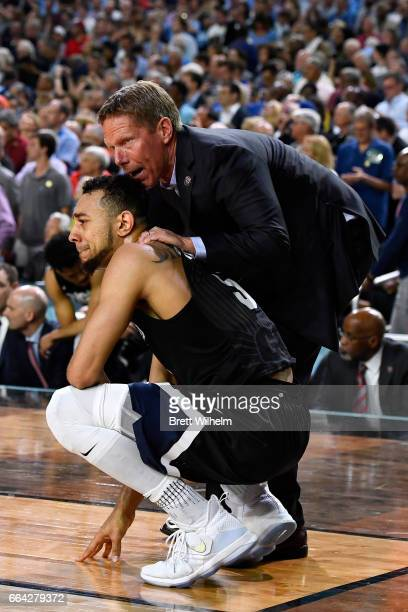 Head coach Mark Few and Nigel WilliamsGoss of the Gonzaga Bulldogs console each other following the 2017 NCAA Men's Final Four National Championship...