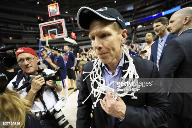 Head coach Mark Few of the Gonzaga Bulldogs celebrates with the net after their 83 to 59 win over the Xavier Musketeers during the 2017 NCAA Men's...