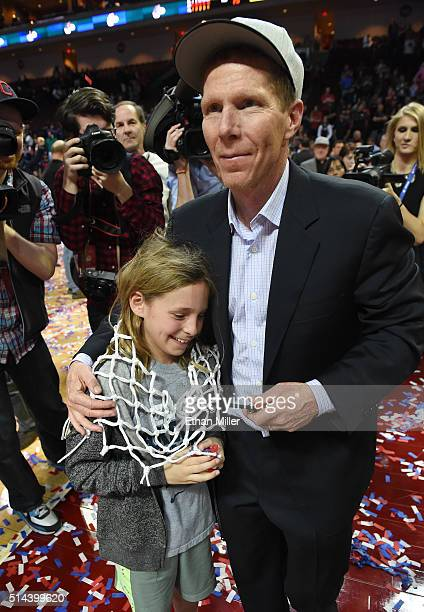 Head coach Mark Few of the Gonzaga Bulldogs walks on the court after giving his daughter Julia Few a net he cut down after the team defeated the...