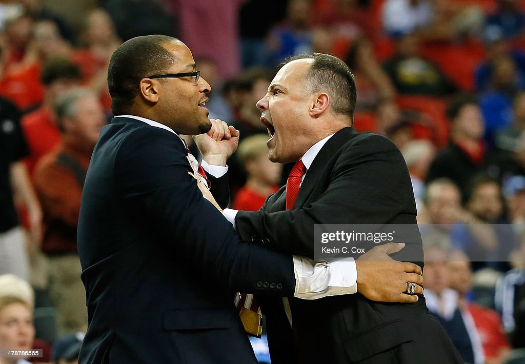 Head coach Mark Fox of the Georgia Bulldogs pushes assistant coach Jonas Hayes away after Fox was called for a tecnical foul during the quarterfinals of the SEC Men's Basketball Tournament at Georgia Dome on March 14, 2014 in Atlanta, Georgia.