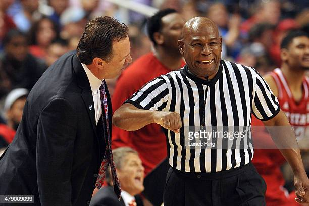 Head Coach Mark Gottfried of the North Carolina State Wolfpack argues with referee Les Jones during a game against the Duke Blue Devils against the...