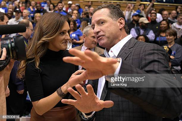 Head coach Mark Gottfried of the North Carolina State Wolfpack is interviewed by ESPN sideline reporter Allison Williams following the game against...