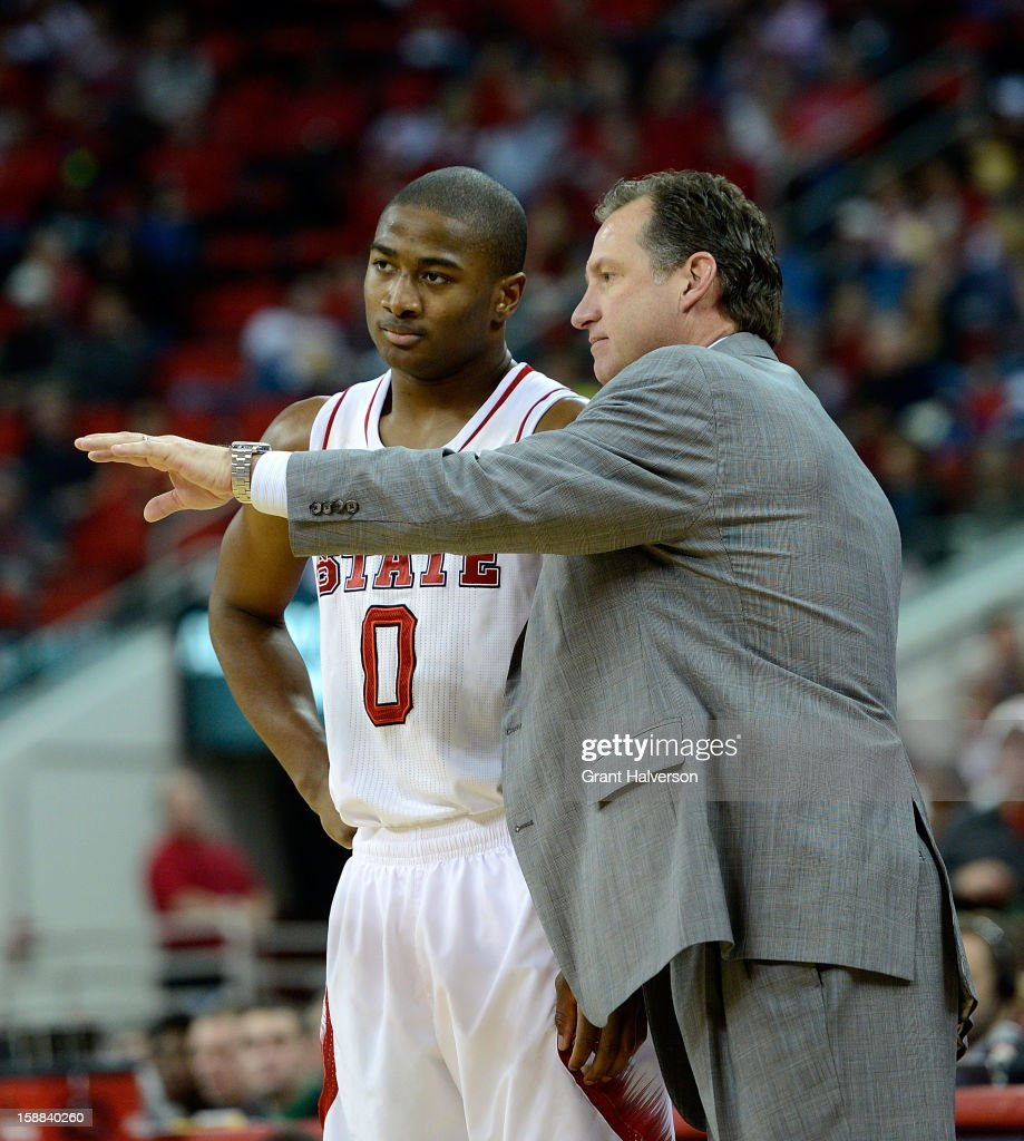 Head coach Mark Gottfried of the North Carolina State Wolfpack talks with Rodney Purvis #0 during a game against the UNC Greensboro Spartans at PNC Arena on December 31, 2012 in Raleigh, North Carolina. North Carolina State won 89-68.
