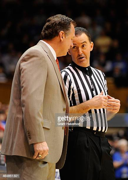 Head coach Mark Gottfried of the North Carolina State Wolfpack talks to official Roger Ayers during a game against the Duke Blue Devils at Cameron...