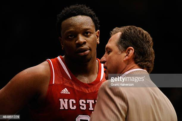 Head coach Mark Gottfried talks with Beejay Anya of the North Carolina State Wolfpack during their game against the Duke Blue Devils at Cameron...