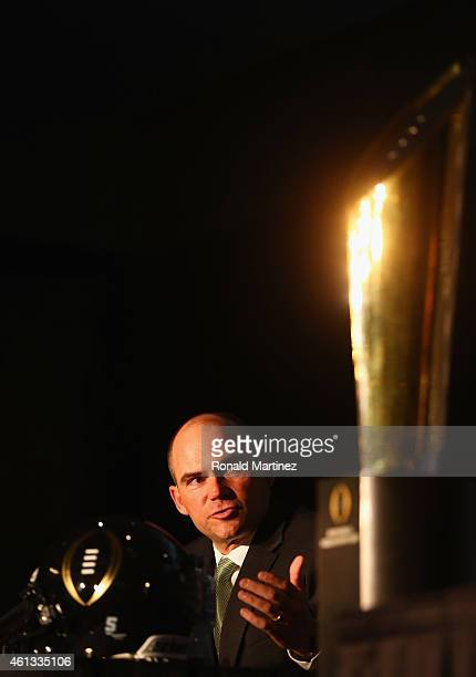 Head Coach Mark Helfrich of the Oregon Ducks speaks with the media in front of the College Football Playoff National Championship trophy during a...
