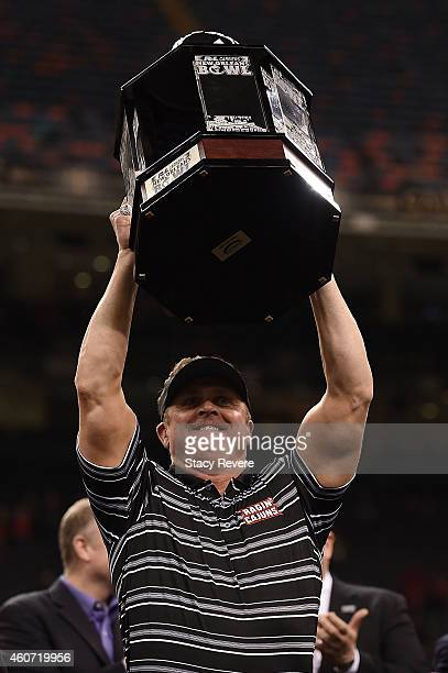 Head coach Mark Hudspeth of the LouisianaLafayette Ragin Cajuns raises the trophy following a victory over the Nevada Wolf Pack in the RL Carriers...