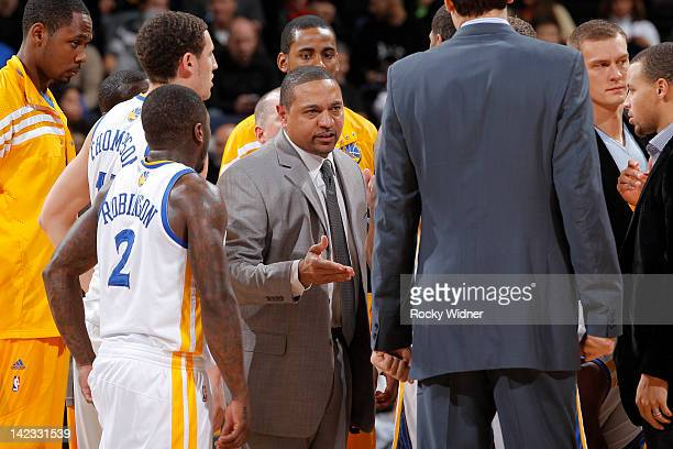 Head coach Mark Jackson of the Golden State Warriors meets up with his team during a game against the Sacramento Kings on March 24 2012 at Oracle...