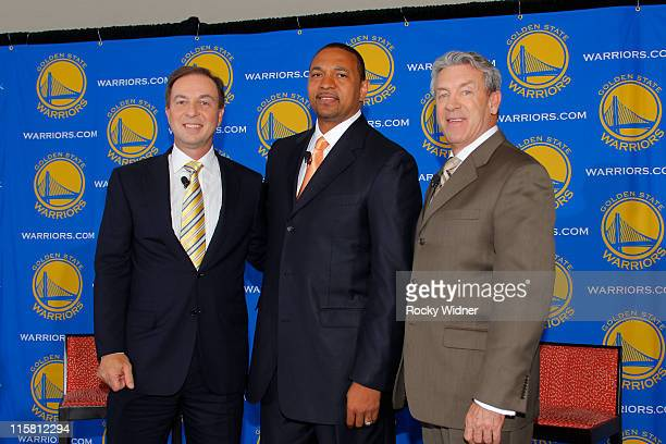 Head Coach Mark Jackson of the Golden State Warriors poses with Warriors Owner Joe Lacob and Warriors GM Larry Riley at Jackson's introductory press...