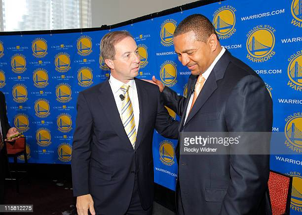 Head Coach Mark Jackson of the Golden State Warriors speaks to Warriors Owner Joe Lacob at Jackson's introductory press conference at the St Regis...