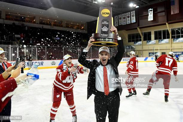 Head Coach Mark Johnson of the Wisconsin Badgers celebrates following the Badgers 2-1 win over the Northeastern Huskies in overtime during the...