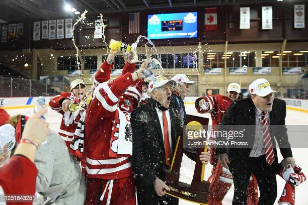 Head Coach Mark Johnson of the Wisconsin Badgers is doused with water following the Badgers 2-1 win over the Northeastern Huskies in overtime during...