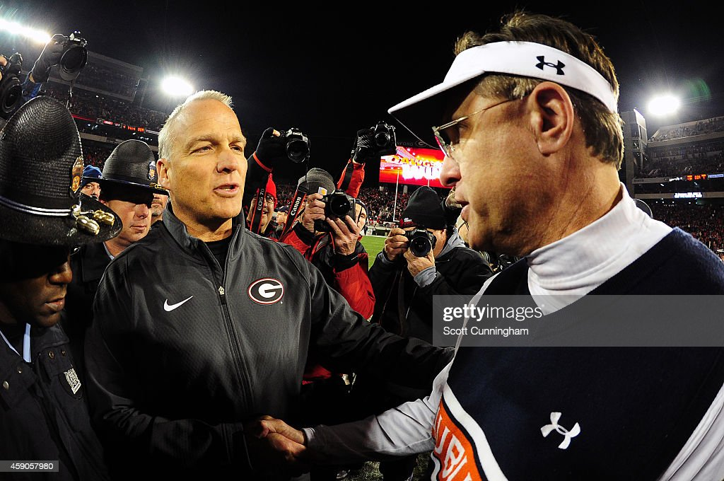 Head Coach Mark Richt (L) of the Georgia Bulldogs is congratulated by Head Coach Gus Malzahn of the Auburn Tigers after the game at Sanford Stadium on November 15, 2014 in Athens, Georgia.