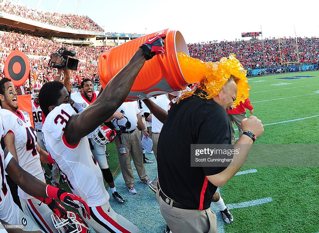 Head Coach Mark Richt of the Georgia Bulldogs is doused with Gatorade by Chris Conley #31 after the Capital One Bowl against the Nebraska Cornhuskers at the Citrus Bowl on January 1, 2013 in Orlando, Florida.