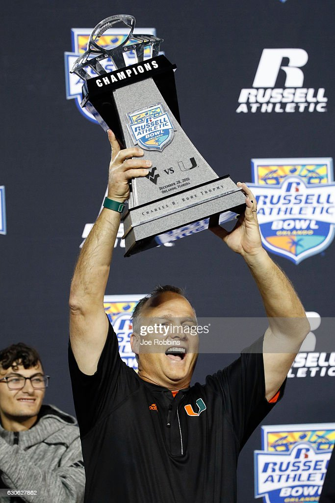 Head coach Mark Richt of the Miami Hurricanes hoists the championship trophy following the Russell Athletic Bowl against the West Virginia Mountaineers at Camping World Stadium on December 28, 2016 in Orlando, Florida. Miami defeated West Virginia 31-14.