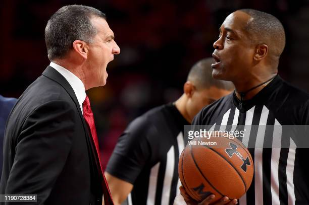 Head coach Mark Turgeon of the Maryland Terrapins reacts to referee Earl Walton after a play against the Bryant University Bulldogs during the second...