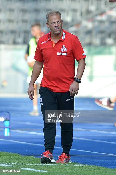 Head coach Markus Anfang of FC Koeln looks on during the DFB Cup first round match between BFC Dynamo and 1 FC Koeln at Olympiastadion on August 19...