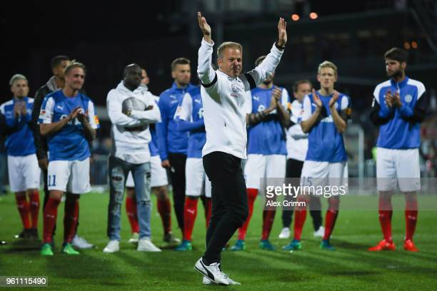 Head coach Markus Anfang of Kiel waves farewell to the fans after the Bundesliga Playoff Leg 2 match between Holstein Kiel and VfL Wolfsburg at...