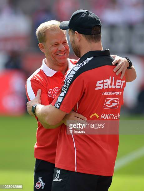 Head coach Markus Anfang of Koeln speaks with Head coach Steffen Baumgart of Paderborn during the Second Bundesliga match between 1 FC Koeln and SC...