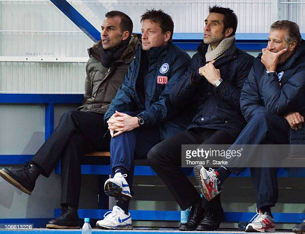 Head coach Markus Babbel assistant coach Rainer Widmayer manager Michael Preetz and staff member Nello di Martino of Berlin look on prior to the...