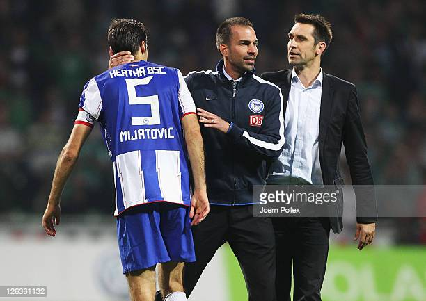 Head coach Markus Babbel manager Michael Preetz and Andre Mijatovic of Berlin are seen after the Bundesliga match between Werder Bremen and Hertha...