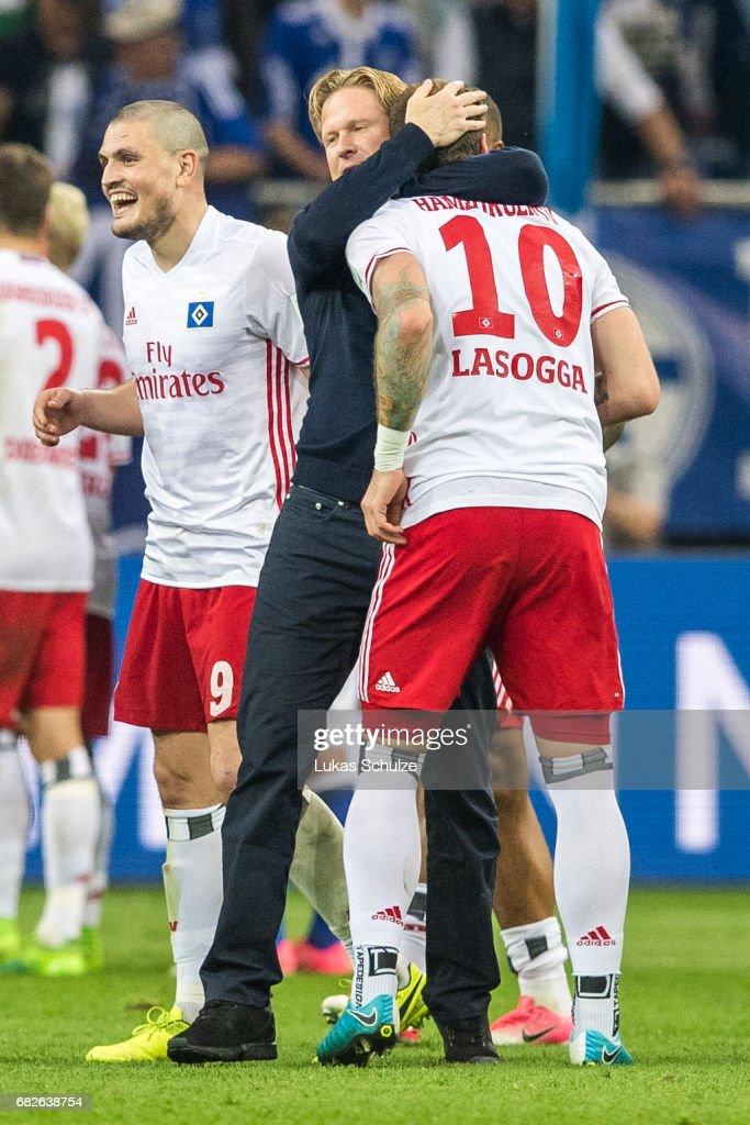 Head Coach Markus Gisdol (C) hugs Pierre-Michel Lasogga (R) after the Bundesliga match between FC Schalke 04 and Hamburger SV at Veltins-Arena on May 13, 2017 in Gelsenkirchen, Germany.