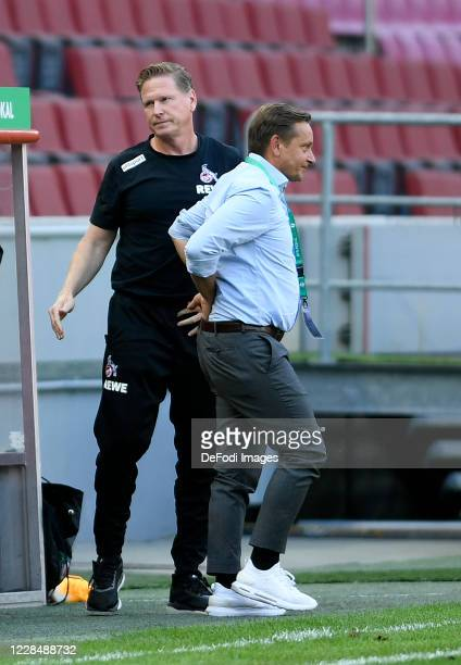 Head coach Markus Gisdol of 1. FC Koeln and Director of sport Horst Heldt of 1. FC Koeln look on after the DFB Cup first round match between VSG...