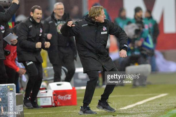 Head coach Markus Gisdol of Koeln celebrates after winning the Bundesliga match between SC Paderborn 07 and 1. FC Koeln at Benteler Arena on March...