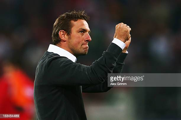 Head coach Markus Weinzierl of Augsburg celebrates after the Bundesliga match between FC Augsburg and SV Werder Bremen at SGL Arena on October 5,...