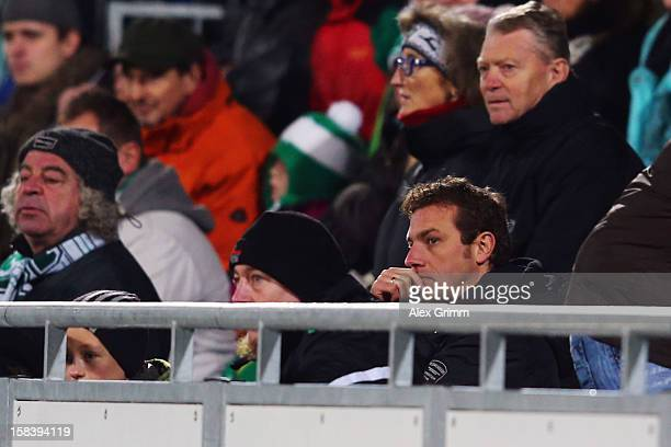 Head coach Markus Weinzierl of Augsburg views the end of the match from the tribune after being sent off by referee Felix Zwayer during the...