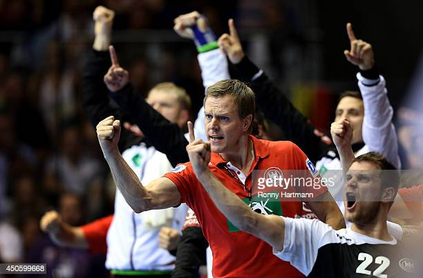 Head coach Martin Heuberger of Germany celebrates during the IHF World Championship 2015 Playoff Leg Two between Germany and Poland at GetecArena on...