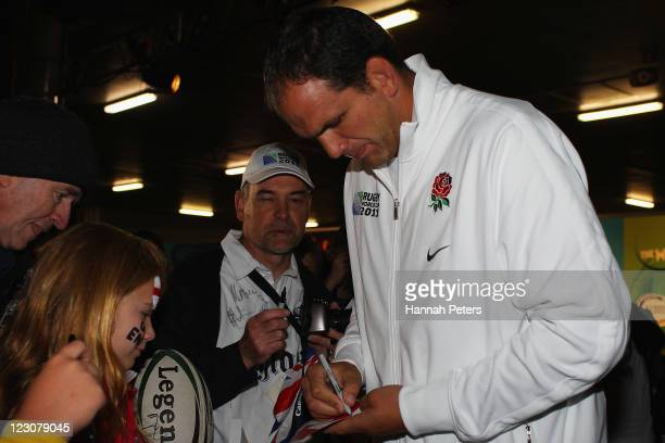 Head coach Martin Johnson of the English IRB Rugby World Cup 2011 team signs autographs after arriving at Auckland International Airport on August 31...