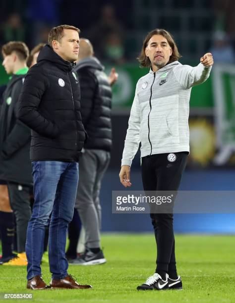 Head coach Martin Schmidt and team manager Olaf Rebbe of Wolfsburg react after the Bundesliga match between VfL Wolfsburg and Hertha BSC at...