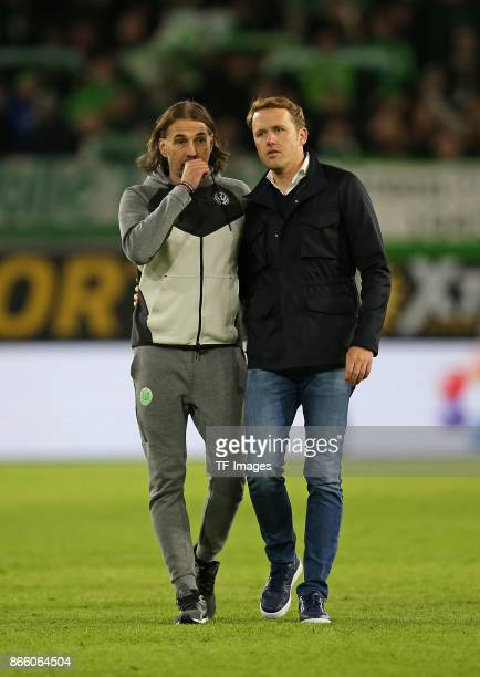 Head coach Martin Schmidt of Wolfsburg and Olaf Rebbe of Wolfsburg looks on during the Bundesliga match between VfL Wolfsburg and TSG 1899 Hoffenheim...