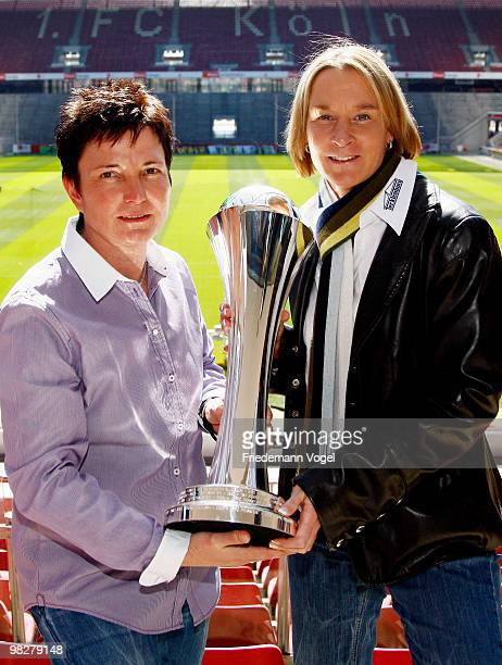 Head coach Martina VossTecklenburg of FCR 2001 Duisburg and head coach Heidi Vater of FF USV Jena pose with the trophy before the DFB press...