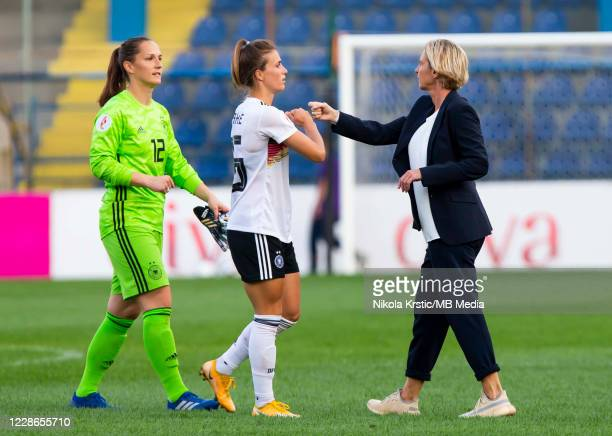 Head Coach Martina VossTecklenburg of Germany greets her players during the UEFA Women's EURO 2022 Qualifier match between Montenegro and Germany at...