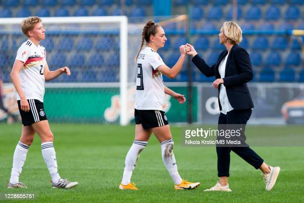 Head Coach Martina VossTecklenburg of Germany greets Sophia Kleiherne of Germany during the UEFA Women's EURO 2022 Qualifier match between Montenegro...