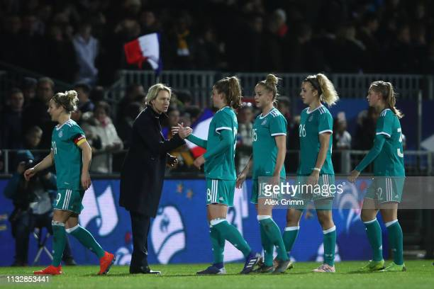 Head coach Martina VossTecklenburg of Germany shakes hands with Melanie Leupolz after the Women's International Friendly match between France Women...