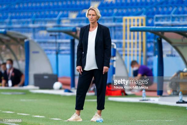 Head Coach Martina VossTecklenburg of Germany watches her players on the field during the UEFA Women's EURO 2022 Qualifier match between Montenegro...