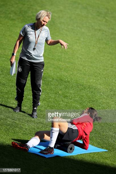 Head coach Martina VossTecklenburg speask to Dzsenifer Marozsan during a Germany Women's training session at Stadion Essen on September 18 2020 in...
