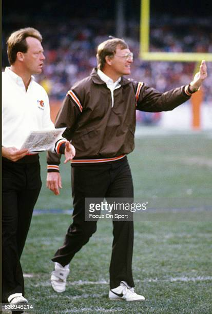 Head Coach Marty Schottenheimer of the Cleveland Browns looks on from the sidelines during an NFL football game circa 1987 at Cleveland Municipal...