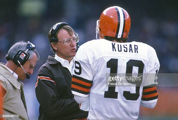 Head Coach Marty Schottenheimer of the Cleveland Browns talks with his quarterback Bernie Kosar during an NFL football game circa 1987 at Cleveland...