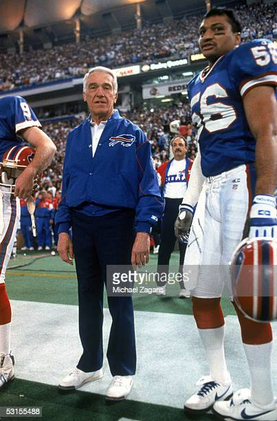 Head coach Marv Levy and Darryl Talley of the Buffalo Bills stand on the sideline during Super Bowl XXVI against the Washington Redskins at the...
