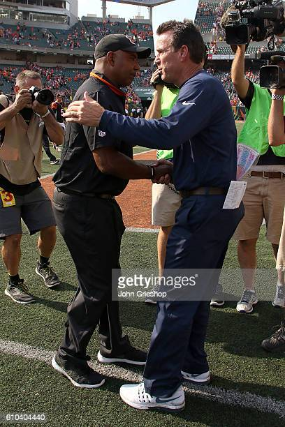 Head Coach Marvin Lewis of the Cincinnati Bengals and Head Coach Gary Kubiak of the Denver Broncos shake hands at the end of the game at Paul Brown...
