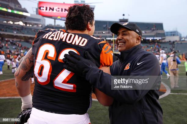 Head coach Marvin Lewis of the Cincinnati Bengals celebrates with Alex Redmond after the game against the Detroit Lions at Paul Brown Stadium on...