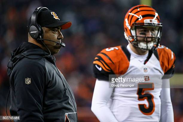 Head coach Marvin Lewis of the Cincinnati Bengals looks on alongside quarterback AJ McCarron at Sports Authority Field at Mile High on December 28...