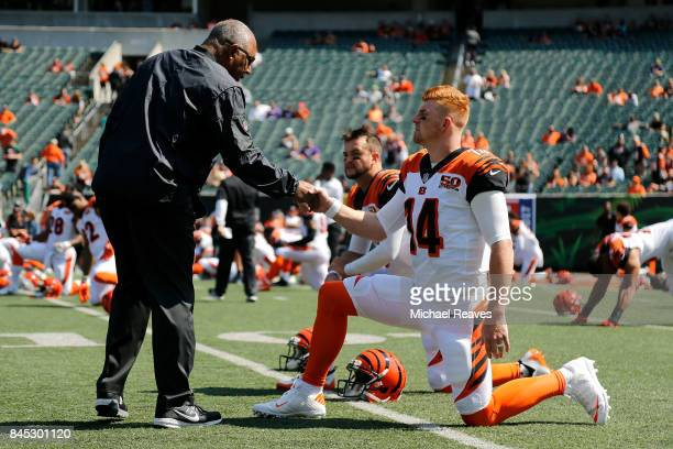 Head coach Marvin Lewis of the Cincinnati Bengals shakes hands with Andy Dalton of the Cincinnati Bengals prior to the start of the game against the...