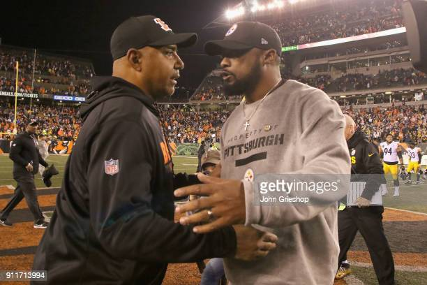 Head Coach Marvin Lewis of the Cincinnati Bengals shares a moment at midfield with Head Coach Mike Tomlin of the Pittsburgh Steelers after their game...