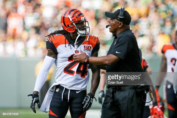 Head coach Marvin Lewis of the Cincinnati Bengals talks to Adam Jones in the first quarter against the Green Bay Packers at Lambeau Field on...