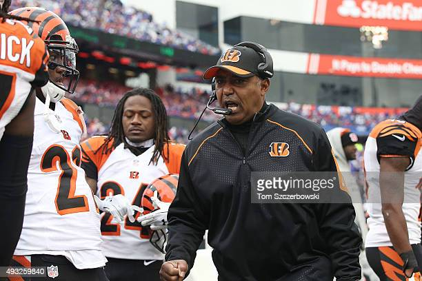 Head Coach Marvin Lewis of the Cincinnati Bengals talks to his team on the sidelines against the Buffalo Bills during the second half at Ralph Wilson...